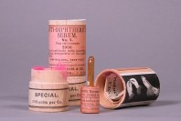A glass ampule and it's wooden tube packaging including literature and illustrations for use.
