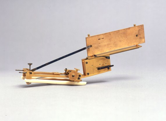 A brass and ivory clockwork instrument.