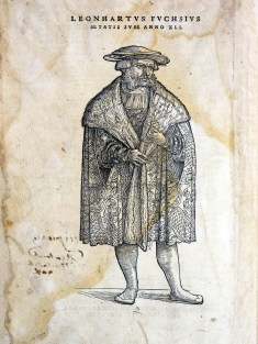 Full length portrait of a man in a fine robe and hat.