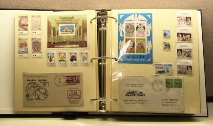 2 mounting pages showing re-housed stamps.