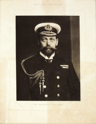 A scrpbook photograph of King George V.