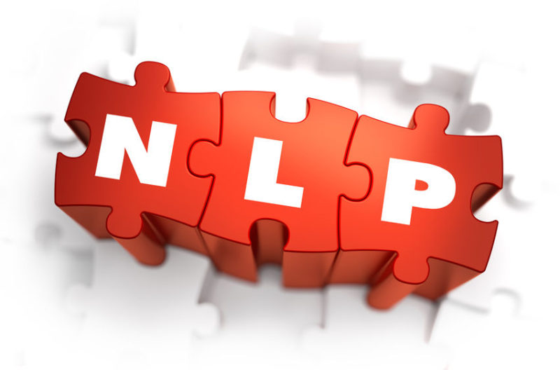 39930442 - nlp - neuro linguistic programming - white word on red puzzles on white background. 3d render.