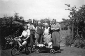 Phillip Holt in his peddle racing car, plus family. Kath, my father, Grand Father, Grand Mother and Uncle Fred