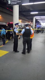 Special Constables and a TTC official discuss transit shutdown after stabbing.