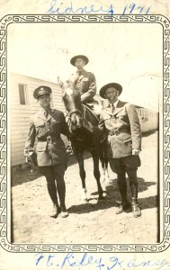 """Sidney Fishman on horseback with two other soldiers. Caption on back: """"Troop 'C', 1st Training Squadron, Ft. Riley, KS. Approx April 1941. All are Jewish."""""""