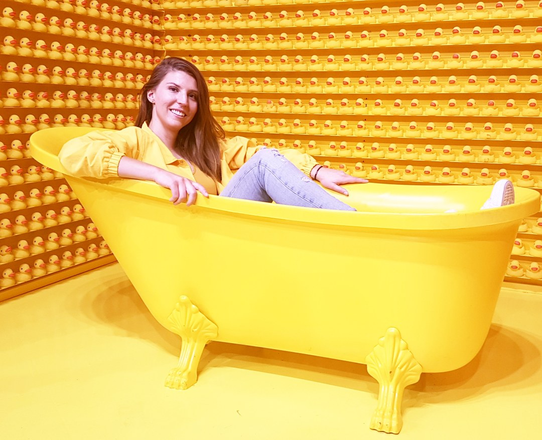 Yellow bathtub and rubber ducks