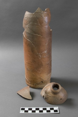 "German stoneware mineral water bottle from Cove House. Stamped ""HN"" and ""EMSER KESSELWASSER"" (Photo by Norm Eggert for NMSC)"