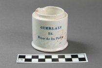 "Tin-enameled ointment pot from VanDeventer-Fountain House. Printed ""Guerlain 15 Rue de la Paix"" (Photo by Norm Eggert for NSMC)"