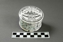 "Whiteware tooth paste pot from VanDeventer-Fountain House. Printed ""Oriental Tooth Paste...Jewsbury & Brown Chemists...Manchester"" (Photo by Norm Eggert for NMSC)"