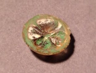 19th-century button from archeology collection at Lowell National Historical Park. Photo by Norm Eggert for NMSC.