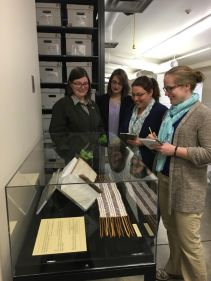 NMSC staff and FOST staff viewing objects from FOST museum collection.