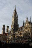 Marienplatz. The Neues Rathaus, new city hall, is the prominent building. It houses the glockenspiel that plas hourly. The two towers on the left are part of the Frauenkirche, a Catholic cathedral and a common symbol of Munich.