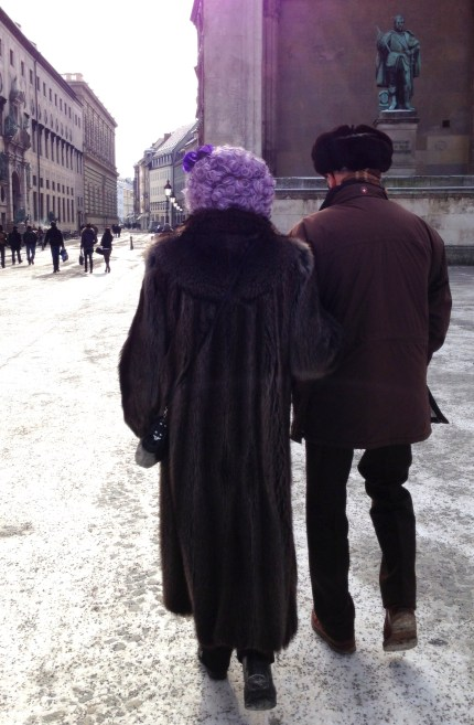 Even the most wealthy and conservative in Bavaria must celebrate Fasching in costume. I love the combination of the full fur coat and the purple wig.