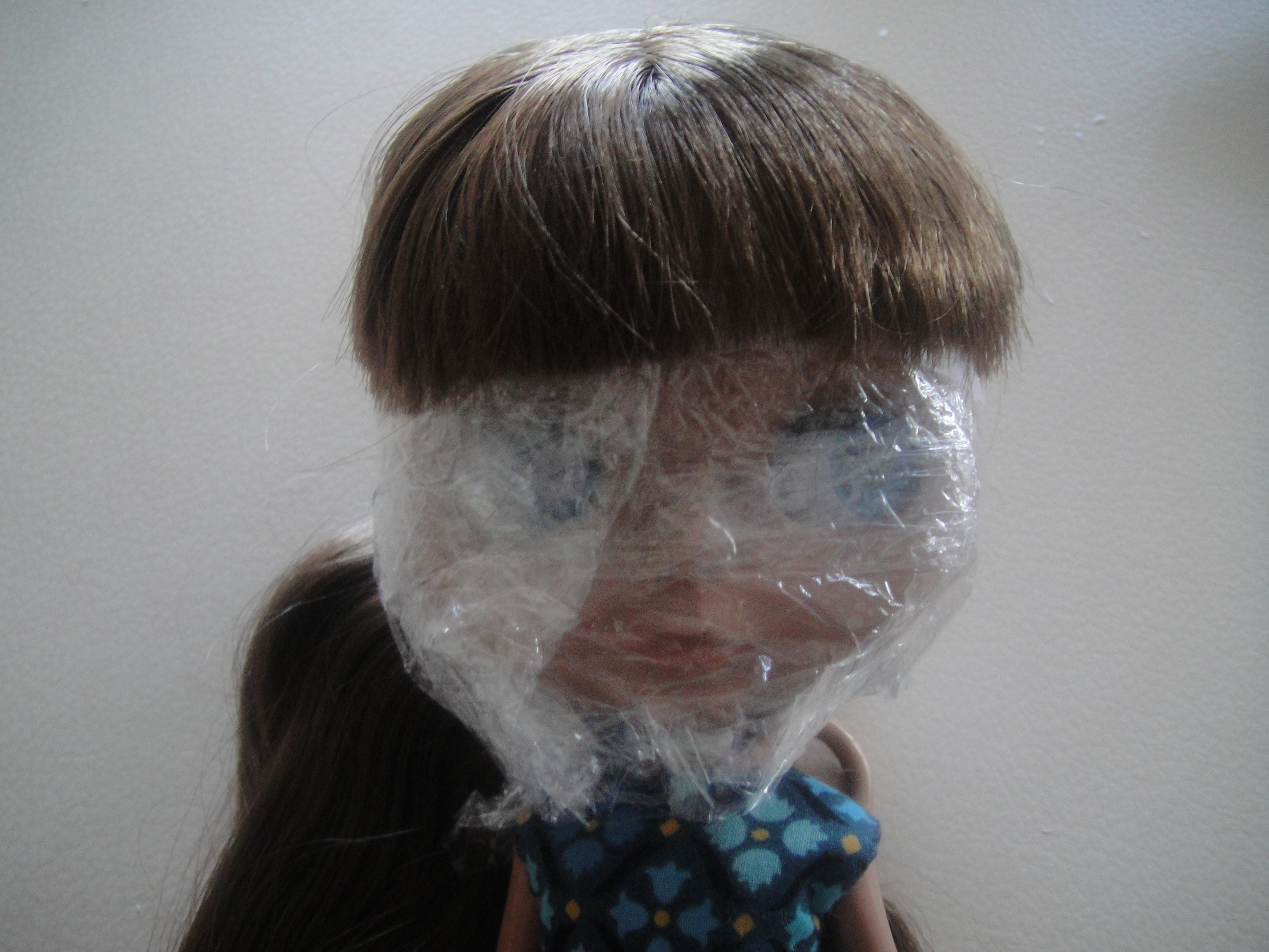 Asha's covered face