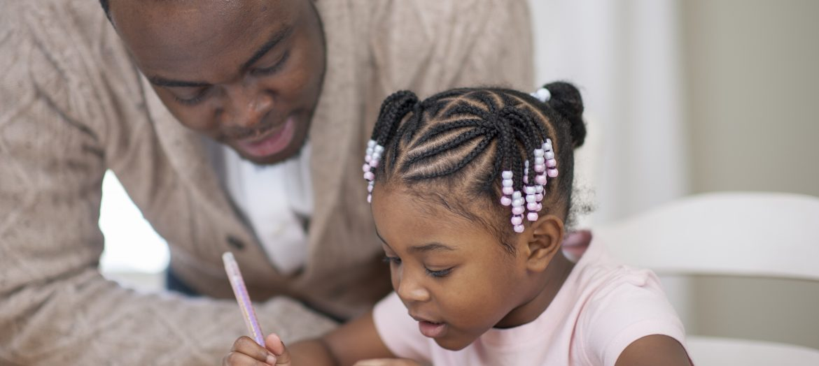 Father teaching his daughter.