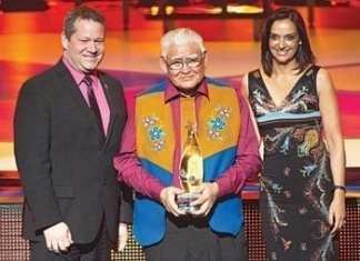 Fort McPherson's Charlie Snowshoe was presented with an Indspire Award for his environmental work during a ceremony in Winnipeg on March 21. From left, Glen Abernethy, minister of health and social services, Charlie Snowshoe and Arielle Meloul-Wechsler, vice president of human resources for Air Canada. - photo courtesy of Indspire