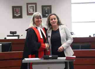 Rebecca Alty, right is sworn in as Mayor by Justice Louise Charbonneau. Dylan Short/NNSL photo