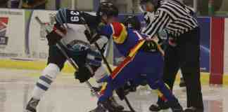 Andrew Carr looks to win a face off against Team Nunavut's Chase Herron. Dylan Short/NNSL photo