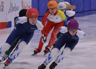 Emma Carpenter (in orange helmet cover) prepares to go into a turn during her heat in the girls 1,500-metre event at the Canada Winter Games in Red Deer, Alta., on Feb. 17. Jerrold Leblanc/Canada Winter Games photo