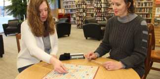 Kandace Groenewegen, left, and Tatiana Petrov, the program librarian at NWT Centennial Library, demonstrate how to play Scrabble. The library will be hosting the Deep Winter Scrabble Tournament on Feb. 23. Paul Bickford/NNSL photo