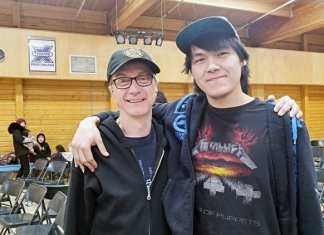 Innosar Issakiark, right, and drama teacher Gord Billard are all smiles while attending a screening of the Grizzlies in Arviat on Feb. 20, 2019. Photo courtesy Gord Billard