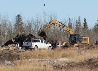 The now extinuished fire at the landfill site will be costly for the Town of Hay River. The expenses - like for this excavator working on the almost-extinguished fire on March 22 - may approach $400,000. NNSL file photo