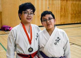 The brother act of Matthew Bui, left, and Luke Bui represented the Yellowknife Wado Kai Karate Club at the South Calgary Wado Kai Karate Tournament last weekend. Matthew Bui ended up bringing home a gold medal thanks to his division win in shindo (three-foot staff). James McCarthy/NNSL photo