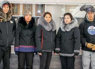 Grade 10 students, from left, Macleod Arnatsiaq, Sabina Iyyiraq, Angelina Siusangnark, Melanie Kaunak and Darryl Angotingoar display their completed jackets during a special jappa-making program at Tuugaalik High School in Naujaat on Feb. 22, 2019. Photo courtesy Julia MacPherson