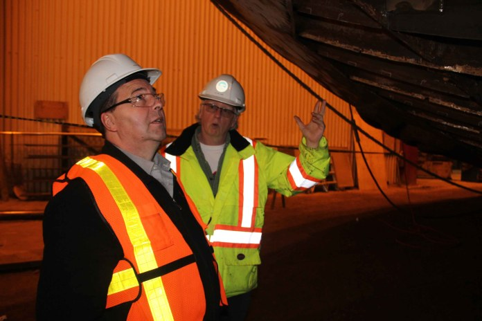 Infrastructure Minister Wally Schumann, left, and Pat Williams, the assistant director of marine maintenance with Marine Transportation Services (MTS), inspect work on the tugboat Jock McNiven during a tour of the MTS Shipyard in Hay River on March 22. Paul Bickford/NNSL photo