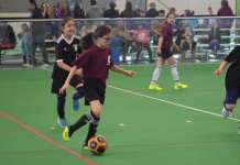 Gisele Deans of St. Joe's heads upfield with the ball during action in the Grade 4-5 Yellowknife Soccer Tournament at the Fieldhouse on Saturday. James McCarthy/NNSL photo