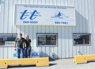 Dennis Althouse and Annette Althouse outside their 325 Old Airport Rd. office and warehouse for Tundra Transfer. Dennis said having a large sign and up to date advertising is very important to let the often transient population of Yellowknife know they are open for business. Brett McGarry / NNSL photo