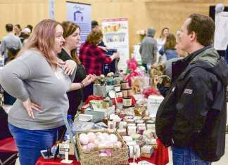 Tiffany Thiem-Pennell, left, chats with Al Matesic at the Good Times Soap Company booth at the trade show in 2017. Business owner Karen Wood can be seen chatting with a visitor in the background. The 2019 trade show begins tomorrow at the Multiplex, starting at 10 a.m. NNSL file photo