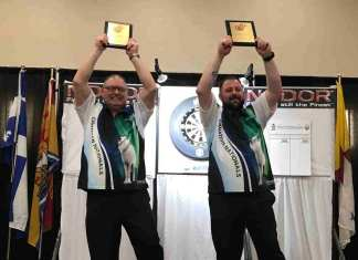 Elvis Beaudoin, left, and Keith Way hoist the champions plaques after winning the mens doubles title at the Adult National Darts Championships in Saskatoon on Tuesday. photo courtesy of Sheh Murillo