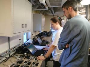 Investigator Christina Schobernd views underwater video with Chief Scientist Nate Bacheler