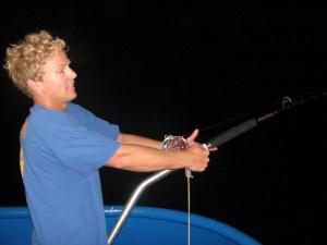 Adam L. reeling in a hammerhead shark