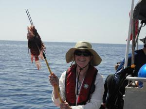 Mrs. Kaiser holding a speared Lionfish. Photo by Jeff Renchen.