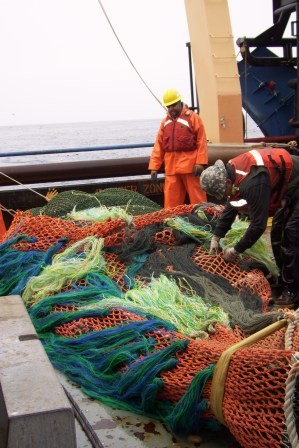 Preparing what looks to be a LARGE catch from the bottom trawl...