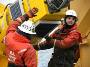 MST2 Tom Kruger and MST3 Marshall Chaidez retrieve a meteorological buoy on September 14.