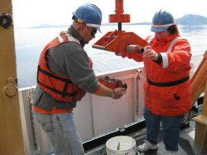 Assistant Survey Technician, Todd Walsh, and I release the bottom sample that was collected from the sea floor.