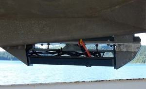 The C3D sonar transducer on the hull of the launch