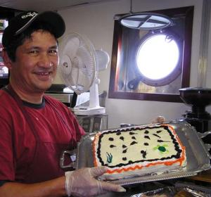 Ray Capati shows off his Turtle Cake. (photo by Karin Forney)