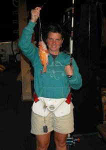 NOAA Teacher at Sea Elizabeth Eubanks holds a Rosie Rockfish.
