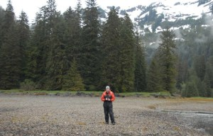 NOAA Teacher At Sea, Clare Wagstaff, in her survival suit on the beach at Lovers Cove, Big Port Walter.