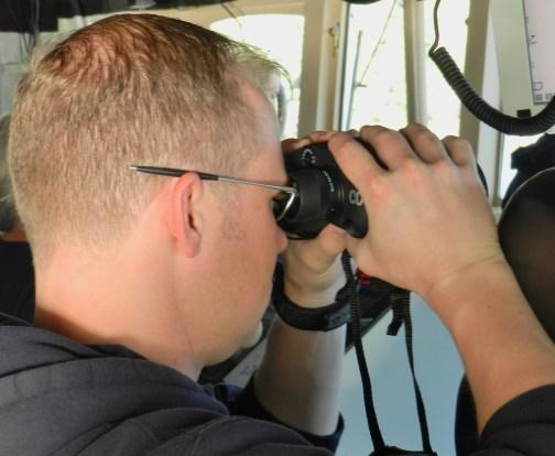 Acting CO Mark Van Waes maintains a vigilant lookout on the bridge
