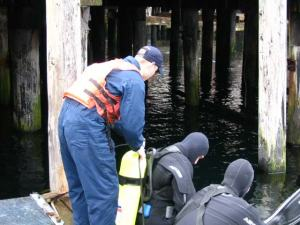 NOAA divers preparing to install a tide gauge at Noyes Island, AK