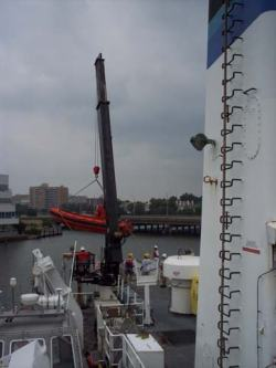 A functioning crane on the NOAA Ship THOMAS JEFFERSON lifts the necessary fast rescue boat (FRB) aboard.