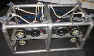 The two cylinders in the center are the cameras and the four other cylinders are strobe lights.