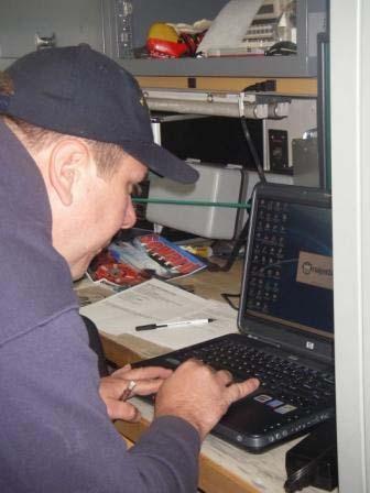 Gary Streeter, RAINIER Engineering Technician examines the laptop for TAS Jacquelyn Hams