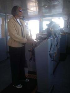 TAS Jacquelyn Hams at the helm of the NOAA Ship RAINIER