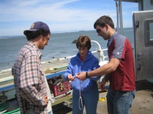 Kit Clark and Troy Benbow demonstrate the bowline to NOAA Teacher at Sea Elsa Stuber.